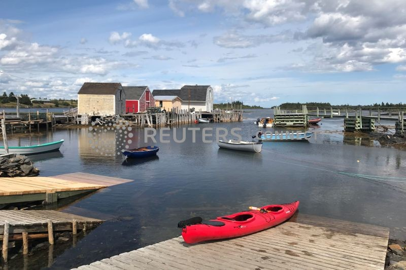 A red kayak is pictured on a dock in Blue Rocks, Nova Scotia, Canada, August 11, 2019. (REUTERS File Photo)