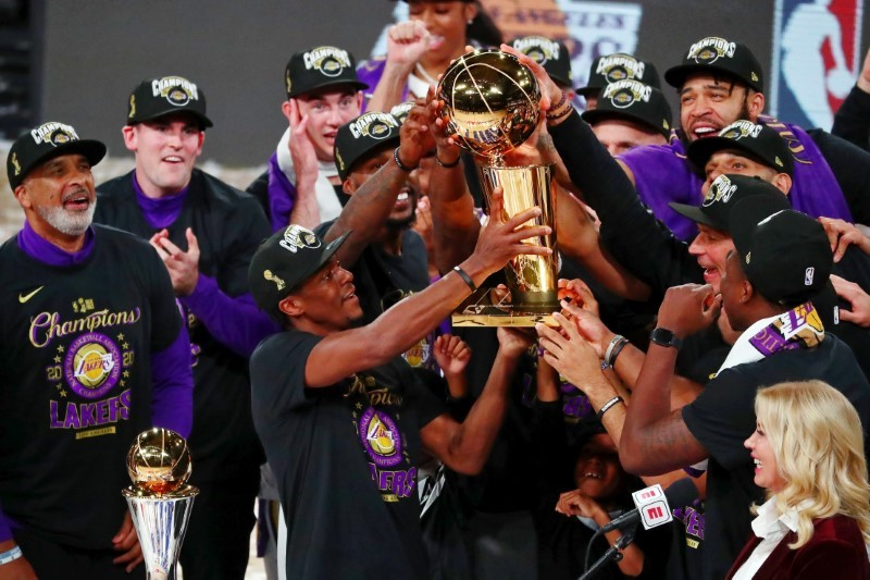 Oct 11, 2020; Lake Buena Vista, Florida, USA; The Los Angeles Lakers hold up the Finals trophy after game six of the 2020 NBA Finals at AdventHealth Arena. The Los Angeles Lakers won 106-93 to win the series. Kim Klement-USA TODAY Sports
