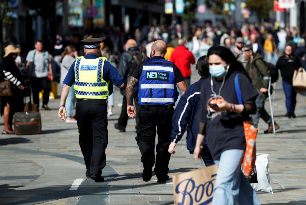 A street ranger and a police community support officer patrol Northumberland Street amid the spread of the coronavirus disease (COVID-19), in Newcastle, Britain, September 18, 2020. REUTERS/Lee Smith