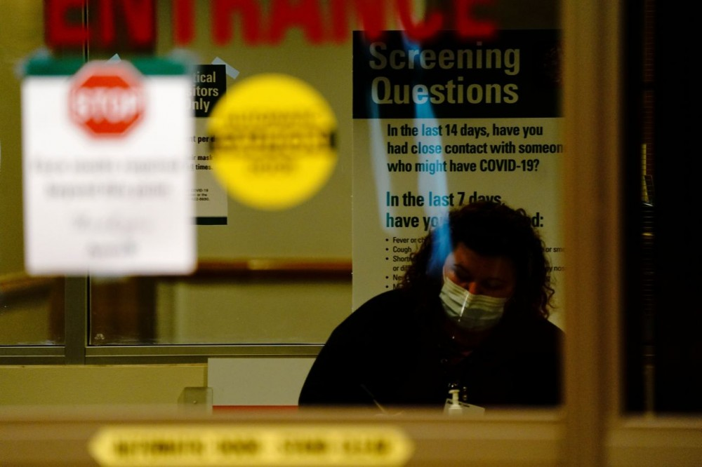 FILE PHOTO: A healthcare worker questions a patient (not pictured) arriving at the emergency room of Avera St. Luke's Hospital as the coronavirus disease (COVID-19) outbreak continues in Aberdeen, South Dakota, U.S., October 26, 2020. REUTERS/Bing Guan