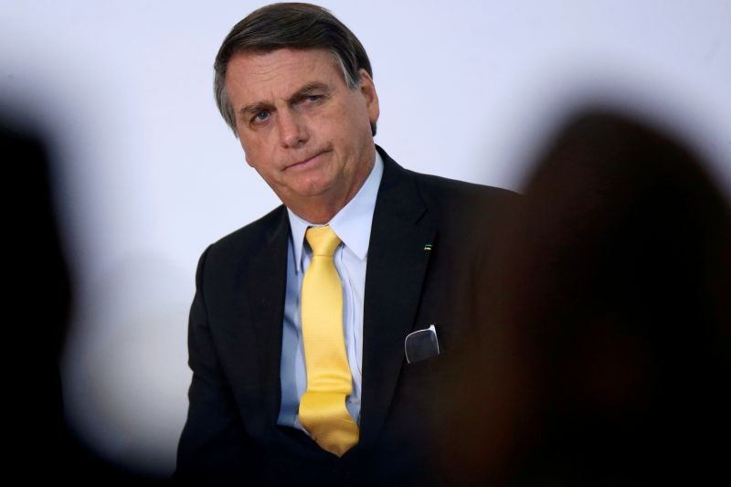 Brazil's President Jair Bolsonaro looks on during the COVID-19 Clinical Study Result Announcement Ceremony at the Planalto Palace in Brasilia, Brazil, October 19, 2020. (REUTERS Photo)