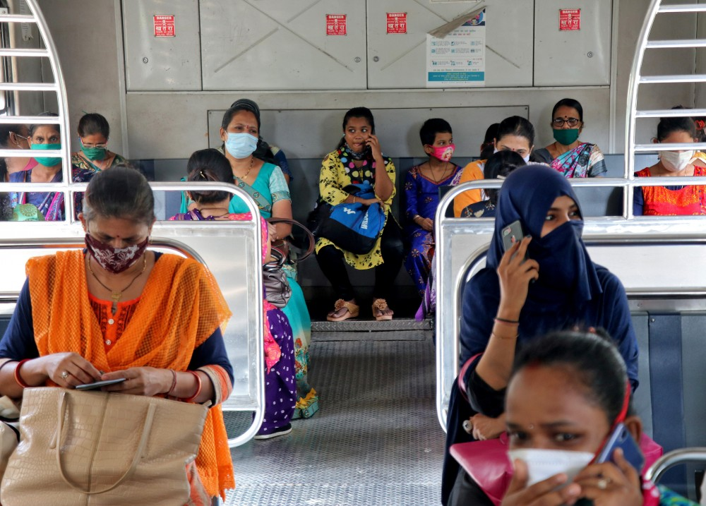 REUTWomen wearing protective face mask commute in a suburban train after authorities resumed the train services for women passengers during non-peak hours, amidst the coronavirus disease (COVID-19) outbreak, in Mumbai, India, October 21, 2020. REUTERS/Niharika KulkarniERS photo