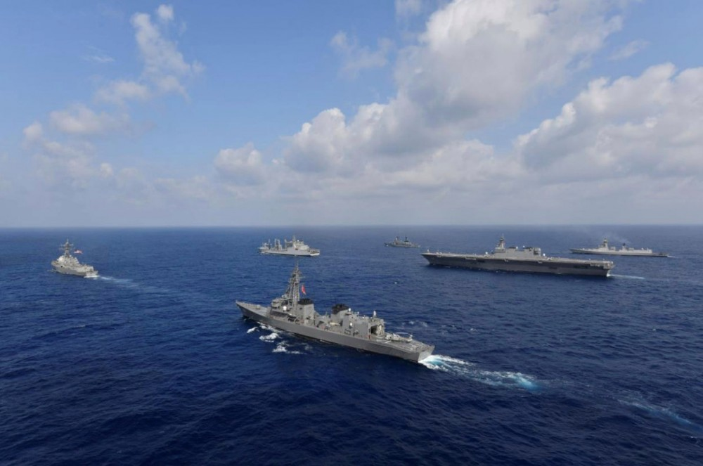FILE PHOTO: Vessels from the U.S. Navy, Indian Navy, Japan Maritime Self-Defense Force and the Philippine Navy sail in formation at sea, in this recent taken handout photo released by Japan Maritime Self-Defense Force on May 9, 2019. Japan Maritime Self-Defense Force/Handout via REUTERS/File Photo