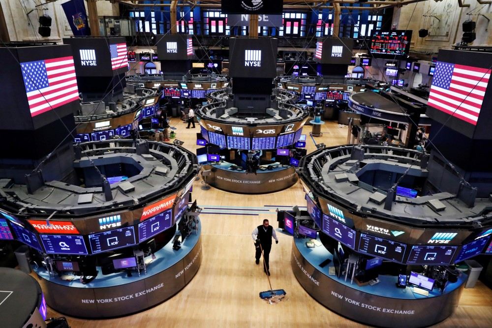 FILE PHOTO: A worker cleans the floor of the New York Stock Exchange (NYSE) , U.S., March 20, 2020. REUTERS/Lucas Jackson/File Photo