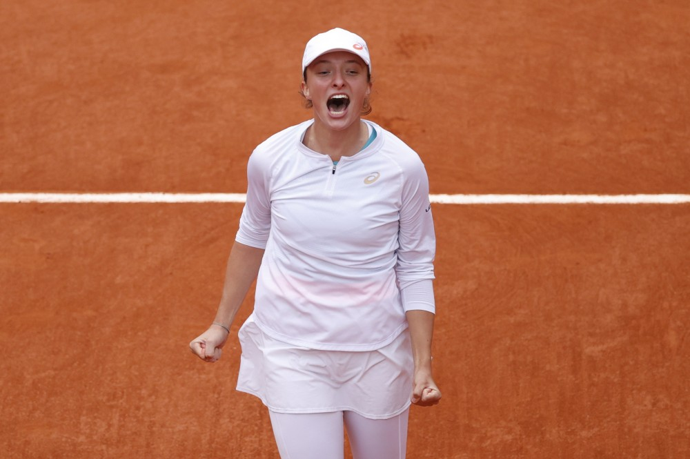 Tennis - French Open - Roland Garros, Paris, France - October 10, 2020. Poland's Iga Swiatek celebrates after winning the French Open final against Sofia Kenin of the U.S. REUTERS/Christian Hartmann
