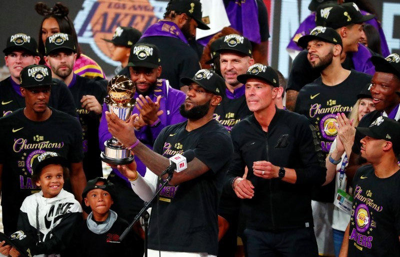 Los Angeles Lakers forward LeBron James (23) holds up the MVP trophy after game six of the 2020 NBA Finals at Advent Health Arena, Lake Buena Vista, Florida on October 11.  The Los Angeles Lakers won 106-93 to win the series. (Photo: Kim Klement-USA TODAY Sports via Reuters)