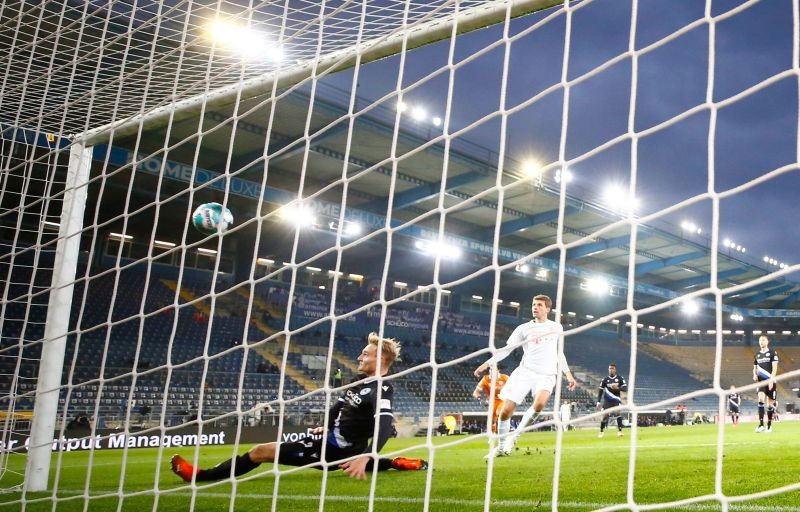 Bayern Munich's Thomas Muller scores their first goal Pool via REUTERS/Wolfgang Rattay