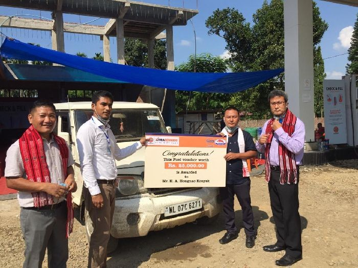 Indian Oil Company officials felicitate Hongnaw Konyak with Rs 25,000 Fuel Voucher Card during the 'check and fill awareness campaign' held at Tizit village petrol pump on October 17.