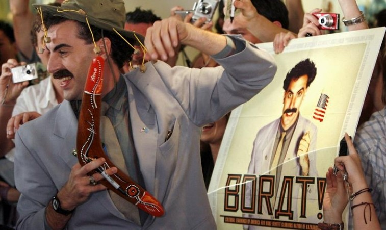 "FILE PHOTO: British actor Sacha Baron Cohen, in character as a Kazakh TV reporter known as 'Borat', holds a boomerang as he mingles with fans in Sydney November 13, 2006 during the Australian premiere of his film ""Borat: Cultural Learnings of America for Make Benefit Glorious Nation of Kazakhstan"". REUTERS/David Gray"