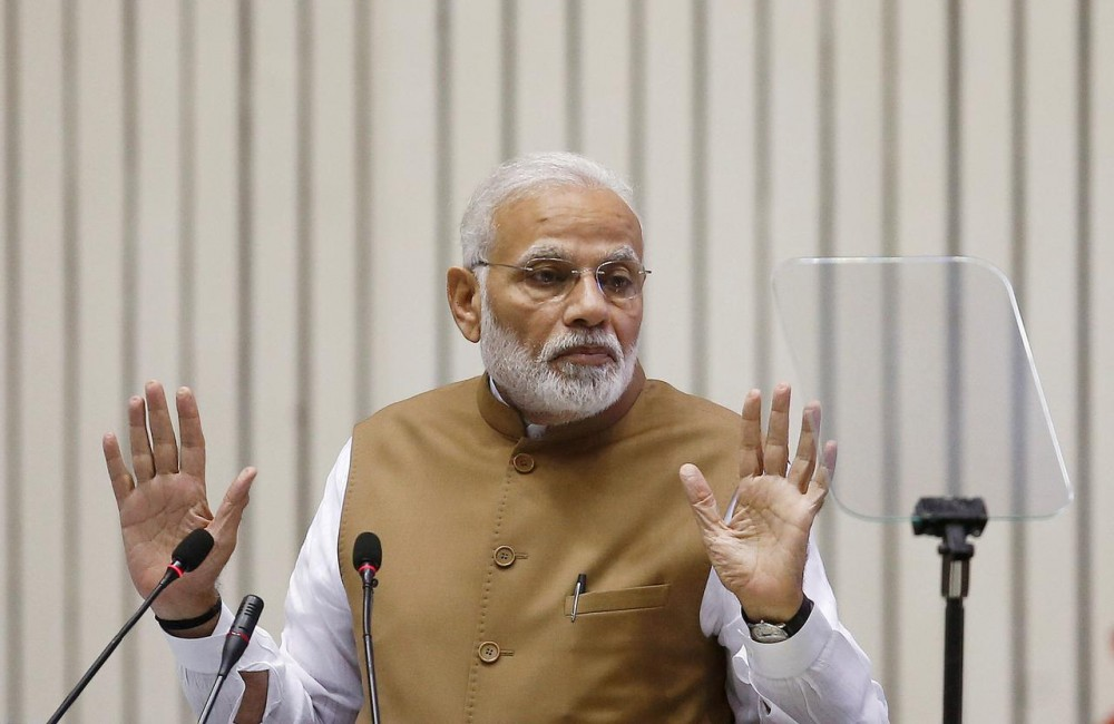 FILE PHOTO: India's Prime Minister Narendra Modi gestures as he addresses the gathering during the 'Global Mobility Summit' in New Delhi, India, September 7, 2018. REUTERS/Adnan Abidi/File Photo