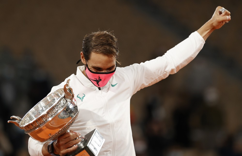 Tennis - French Open - Roland Garros, Paris, France - October 11, 2020 Spain's Rafael Nadal celebrates with the trophy after winning the French Open final against Serbia's Novak Djokovic REUTERS/Christian Hartmann