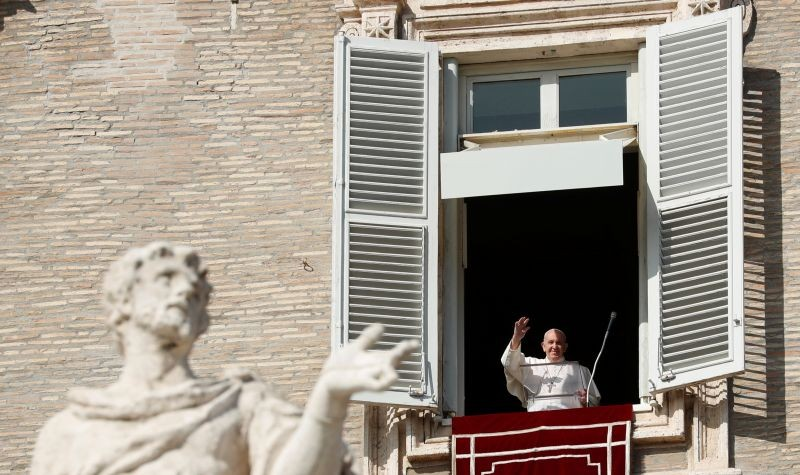 Pope Francis waves his hand during the Angelus prayer held from a window at Saint Peter's Square, Vatican, October 25, 2020. (REUTERS Photo)