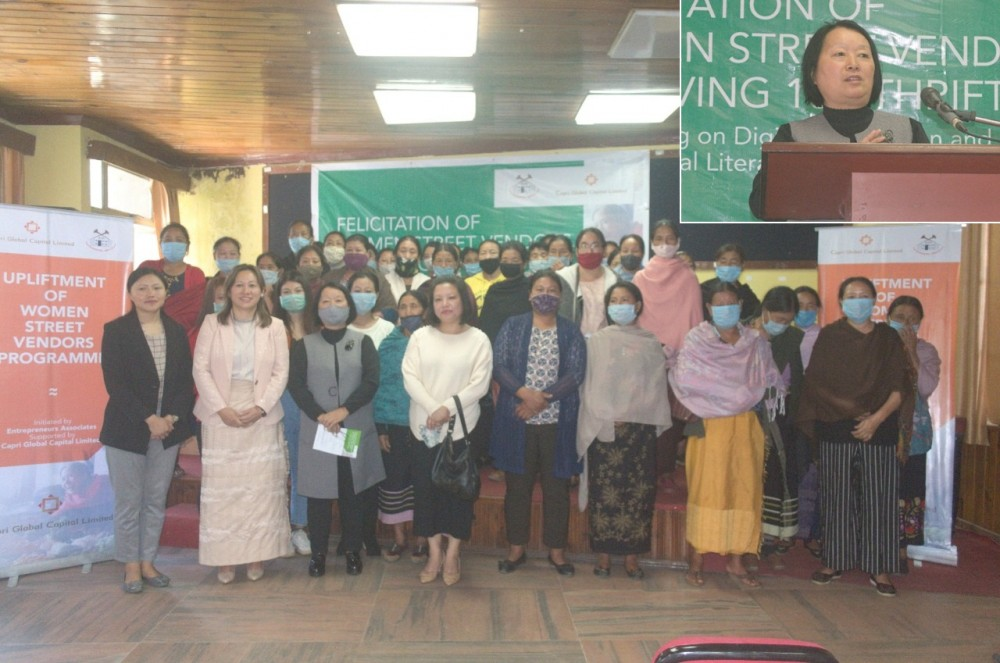 Women street vendors along with Entrepreneurs Associates (EA) officials during a during felicitation programme under PM SVANidhi in Kohima on October 29. (Inset) Nino Iralu, Secretary (Judicial), Law and Justice Department speaking at the event. (Morung Photo)