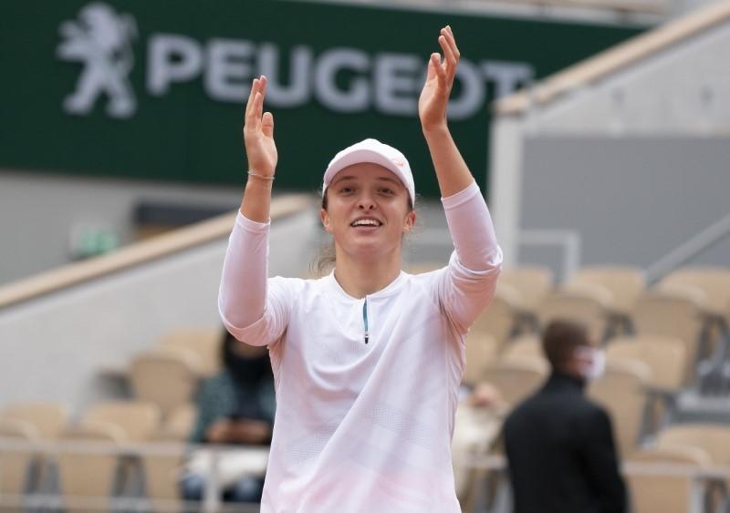 Oct 8, 2020; Paris, France; Iga Swiatek (POL) celebrates match point during her match against Nadia Podoroska (ARG) on day 12 at Stade Roland Garros. Susan Mullane-USA TODAY Sports