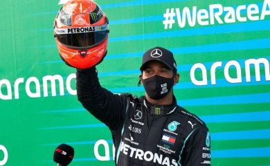 Formula One F1 - Eifel Grand Prix - Nurburgring, Nurburg, Germany - October 11, 2020 Mercedes' Lewis Hamilton poses with a red helmet from Mick Schumacher after winning the race   FIA/Handout via REUTERS