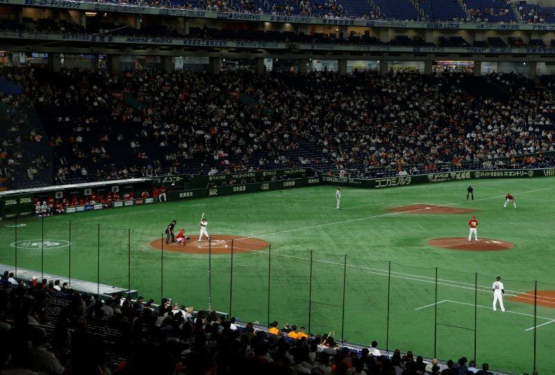 Fans watch Nippon Professional Baseball Game between Yomiuri Giants and Hiroshima Carp at Tokyo dome in Tokyo, Japan October 15, 2020. Picture taken October 15, 2020. REUTERS/Jack Tarrant