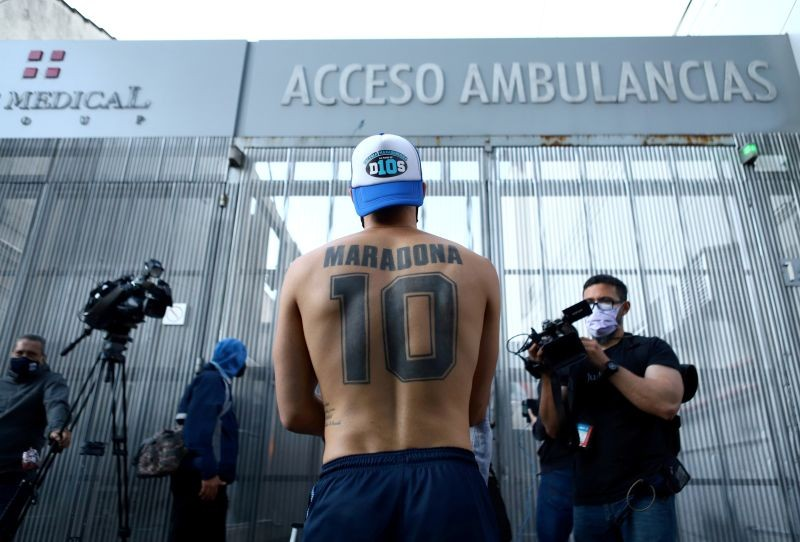 A fan of Argentine soccer great Diego Maradona stands outside the clinic where he will be undergoing surgery for a subdural haematoma, according to his personal physician, in Olivos, on the outskirts of Buenos Aires, Argentina November 3, 2020. REUTERS/Matias Baglietto
