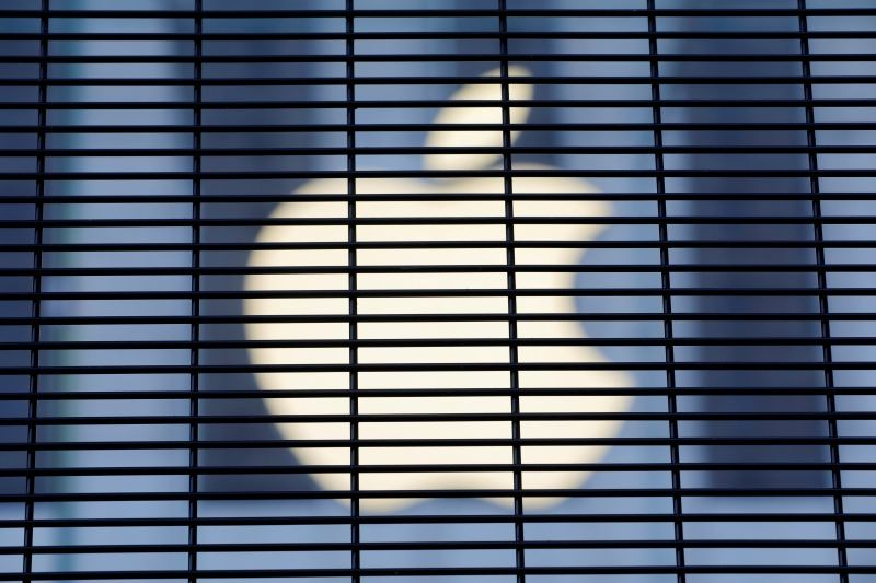 The Apple logo is seen through a security fence erected around the Apple Fifth Avenue store as votes continue to be counted following the 2020 U.S. presidential election, in Manhattan, New York City, U.S., November 5, 2020. (REUTERS File Photo)