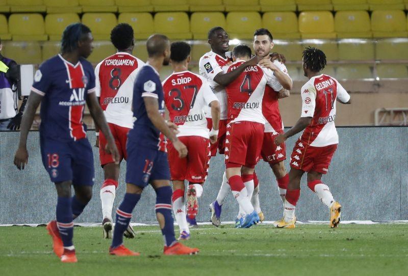 AS Monaco's Cesc Fabregas celebrates scoring their third goal with teammates REUTERS/Eric Gaillard