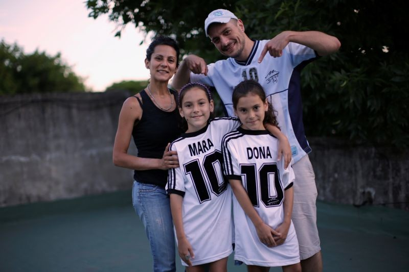 Walter Gaston Rotundo, a devoted Diego Maradona fan who named his twin daughters Mara and Dona after the soccer star, poses with his family in Buenos Aires, Argentina, November 27, 2020. REUTERS/Ueslei Marcelino