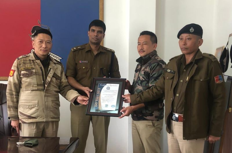 Kohima SP, Manoj Kumar A, IPS, and Additional SP, Talisunep Imchen with the SDPO North, M Yambemo and OC North PS, Chubaonen during the handing over of the ISO certification on November 19. (DIPR Photo)