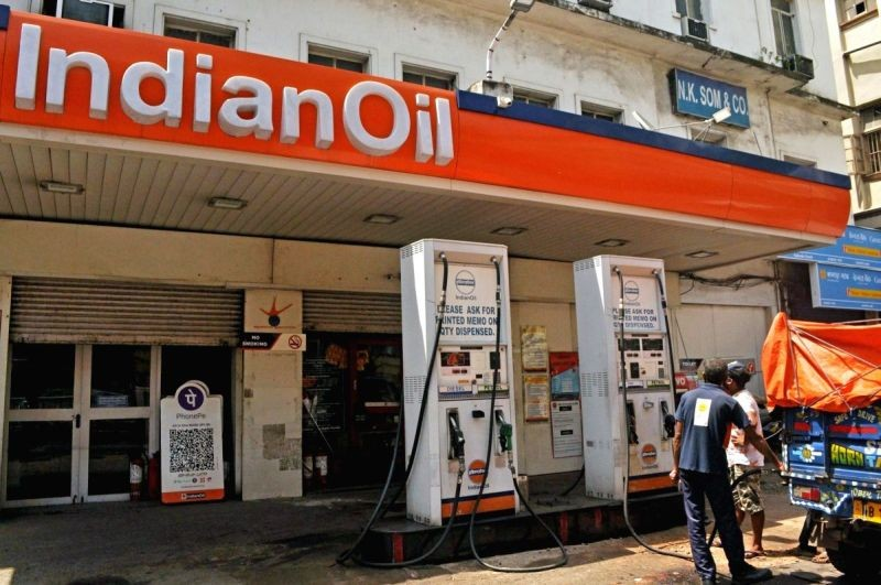 Indian Oil staff attend customers at a petrol pump in Kolkata on June 25, 2020. (IANS File Photo)
