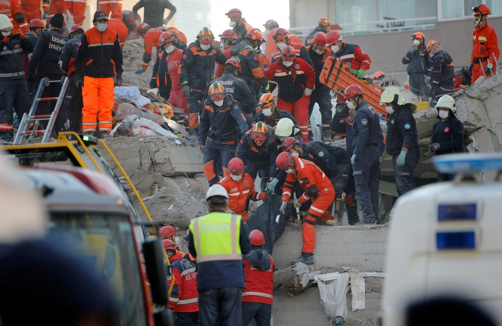 Rescue workers carry an earthquake victim out of a collapsed building in the Aegean port city of Izmir, Turkey, November 1, 2020. REUTERS/Kemal Aslan