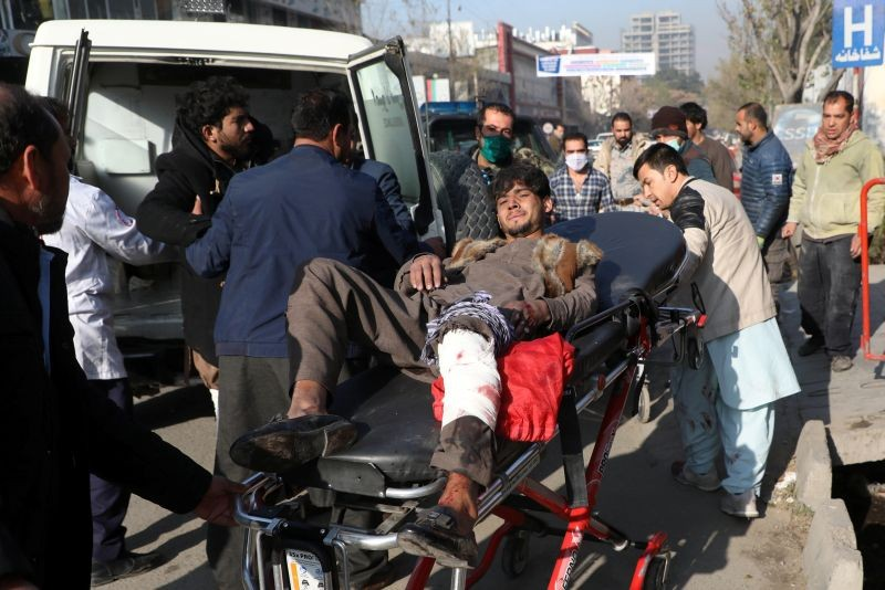 An injured man is carried to a hospital after rockets hit residential areas in Kabul, Afghanistan November 21, 2020. (REUTERS Photo)