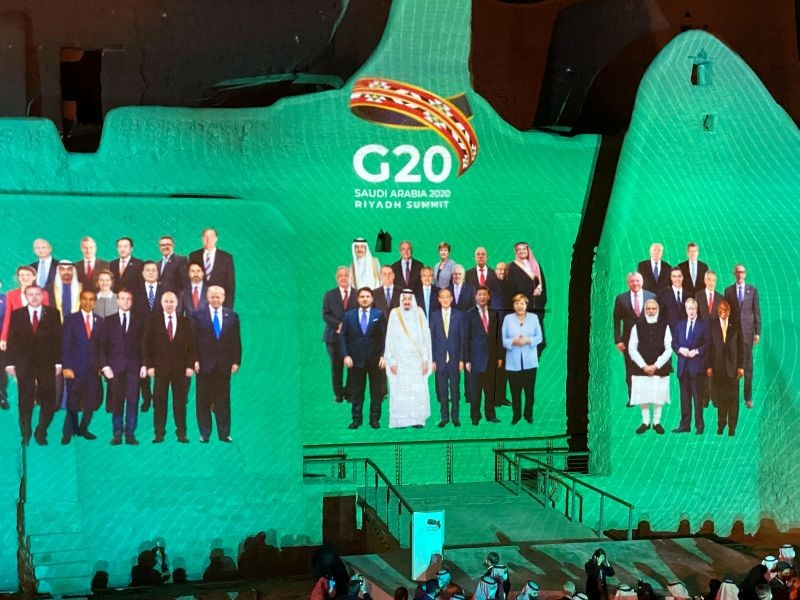 """Family Photo"" for annual G20 Summit World Leaders is projected onto Salwa Palace in At-Turaif, one of Saudi Arabia's UNESCO World Heritage sites, in Diriyah, Saudi Arabia, November 20, 2020. (REUTERS Photo)"