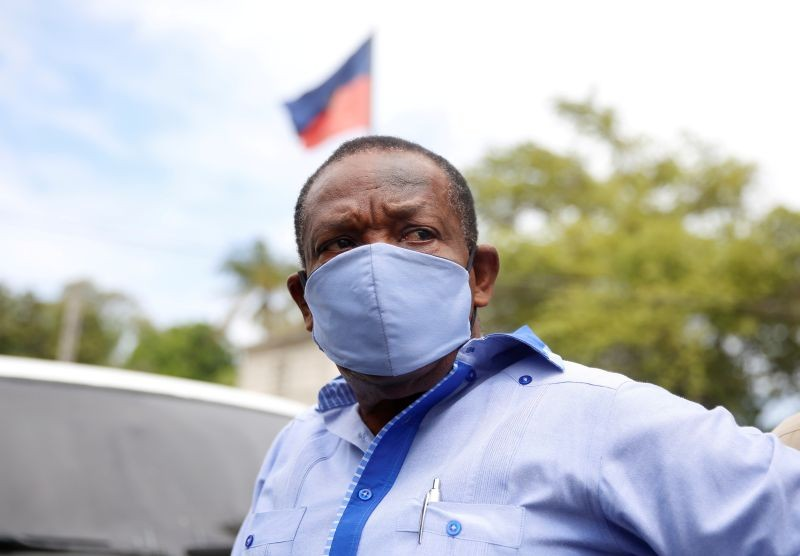 FILE PHOTO: Yves Jean-Bart, president of the Haitian Football Federation, wearing a protective face mask arrives at his hearing at the Crois-Des-Bouquets prosecutor's office, after being accused of sexually abusing young footballers at the country's national training centre, Crois-Des-Bouquets, Haiti, May 14, 2020. REUTERS/Jeanty Junior Augustin/File Photo