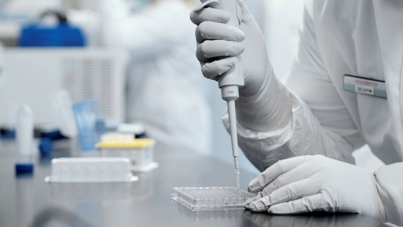 FILE PHOTO: A researcher works in a lab run by Moderna Inc, who said November 16, 2020 that its experimental vaccine was 94.5% effective in preventing COVID-19 based on interim data from a late-stage clinical trial, in an undated still image from video. Moderna Inc/Handout via REUTERS.