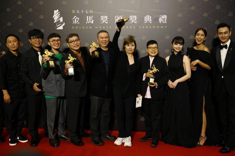 "Director Chen Yu-hsun and others pose with the Best Narrative Feature award for ""My Missing Valentine"" at the 57th Golden Horse Awards in Taipei, Taiwan November 21, 2020. REUTERS/Ann Wang"