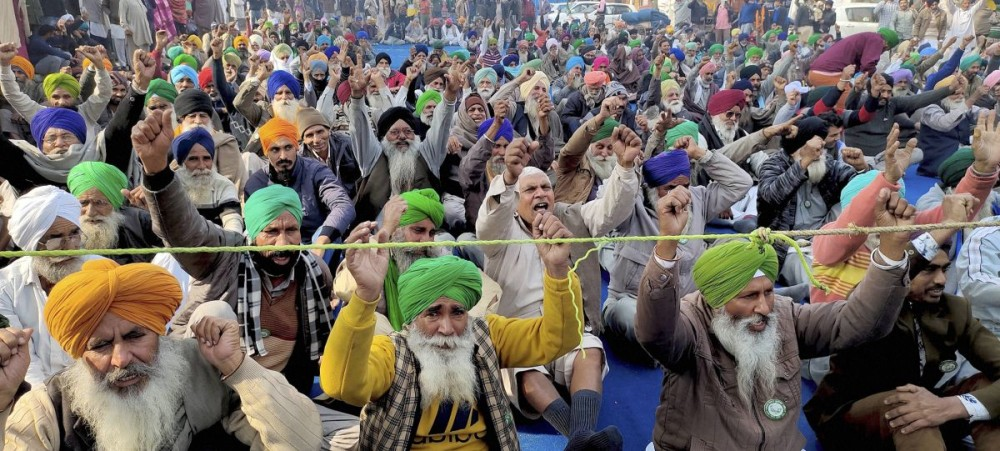 Farmers stage a protest against Centres farm reform laws at Tikri border, in New Delhi. Photograph: PTI Photo