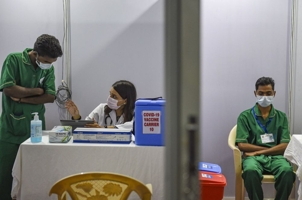 Mumbai: Medics staff sit inside a vaccination booth at BKC in preparation for the first round of COVID vaccination drive scheduled to begin across the country from January 16, in Mumbai, Friday, Jan. 15, 2021. (PTI Photo/Kunal Patil)(