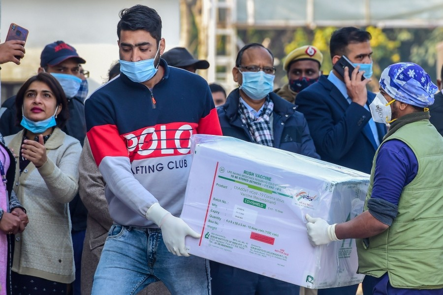 The first batch of Covishield vaccine reaches central storage facility at Rajiv Gandhi Super Specialty hospital in New Delhi, Tuesday, Jan. 12, 2021. (PTI Photo/ Kamal Kishore)