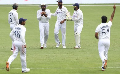 Brisbane : India's Rohit Sharma, second left, reacts as he takes a catch to dismiss Australia's Cameron Green during play on day four of the fourth cricket test between India and Australia at the Gabba, Brisbane, Australia, Monday, Jan. 18, 2021. AP/PTI