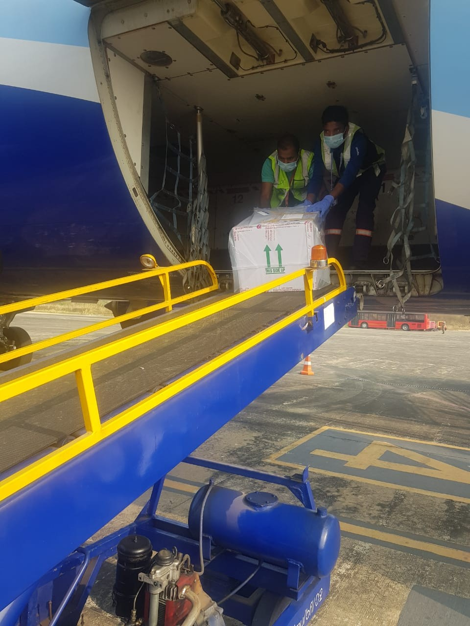 The first consignment of COVID-19 vaccine being unloaded at the Dimapur Airport on January 14. A total of 26500 doses of Covishield vaccine were delivered in the first phase. (@HealthNagaland/Twitter)