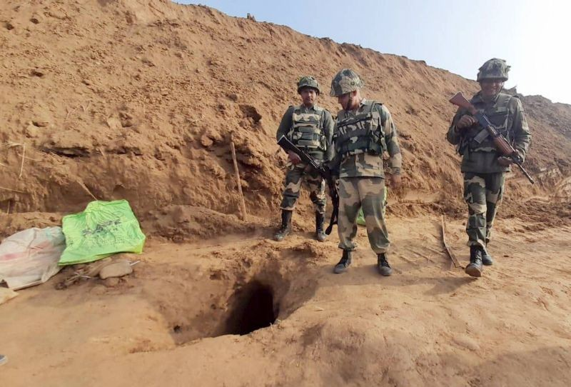 Security officers standing near the mouth of a 150-metre underground tunnel, constructed allegedly by Pakistan beneath International border, at Hiranagar sector of Kathua district on January 13, 2021. (PTI Photo)