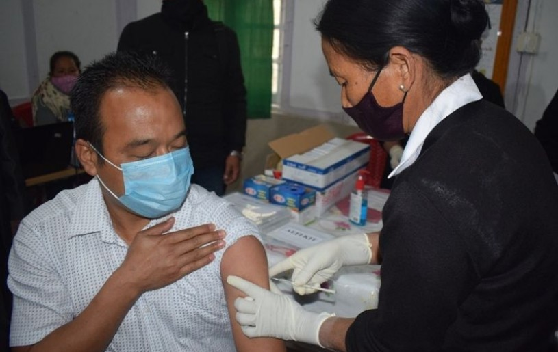 Dr Wabemo Yanthan being administered with COVID-19 vaccine during the launching programme held at Dr Motsuo Memorial District Hospital, Wokha on January 16. (DIPR Photo)
