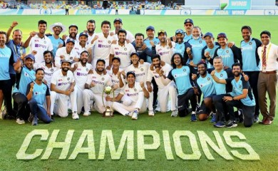 Indian players pose with the winning trophy after defeating Australia by three wickets on the final day of the fourth cricket test match at the Gabba, Brisbane, Australia on January 19, 2021. India won the four test series 2-1. (PTI Photo)