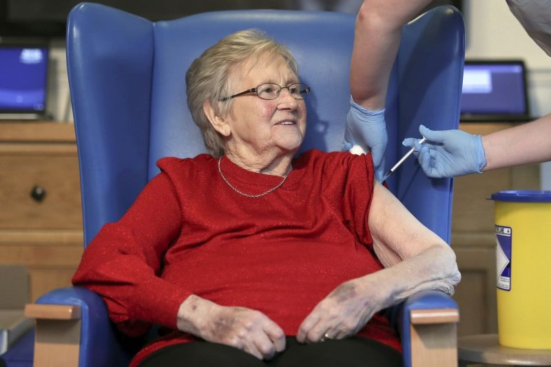 Resident Annie Innes, 90, receives the Pfizer BioNTech COVID-19 vaccine at the Abercorn House Care Home in Hamilton, Scotland on December 14, 2020.  (AP/PTI File Photo)