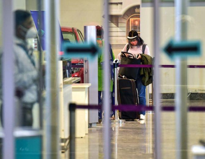 A traveller wearing face mask, as precautionary measure against the coronavirus pandemic, arrives at Kempegowda International Airport in Bengaluru. Photograph: Shailendra Bhojak/PTI Photo