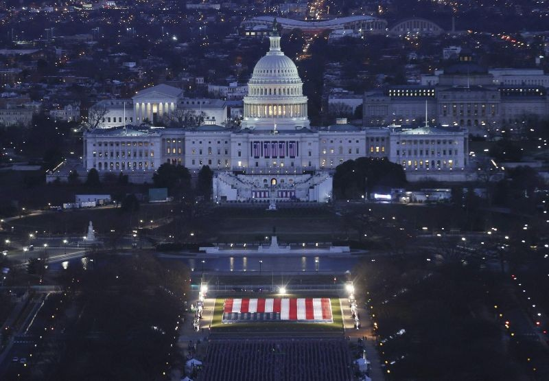 """The U.S. Capitol building is prepared for the inauguration ceremonies for President-elect Joe Biden as the """"Field of Flags"""" are placed on the ground on the National Mall on January 18, 2021. in Washington, DC. (AP/PTI Photo)"""