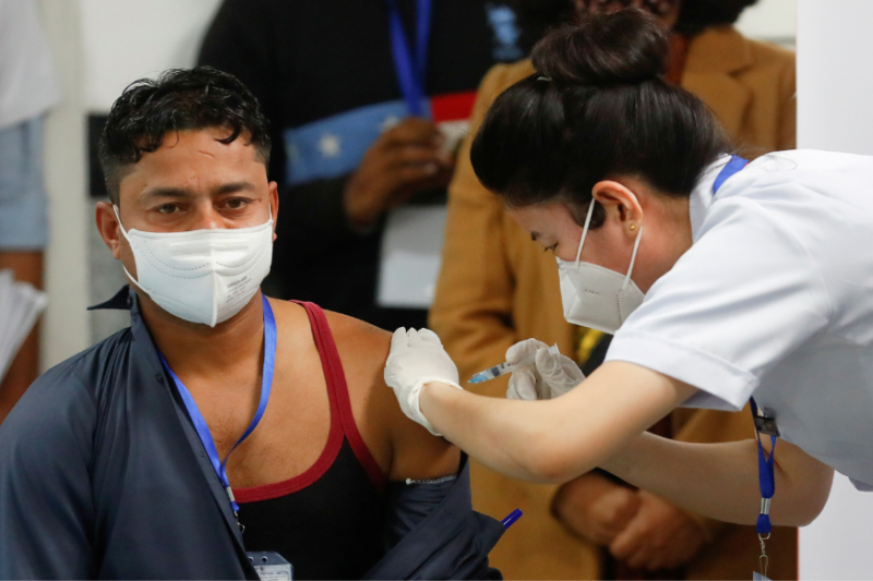 Manish Kumar, a frontline sanitation worker at Delhi AIIMS who received India's first COVID-19 vaccine in New Delhi on January 16. (PTI Photo)