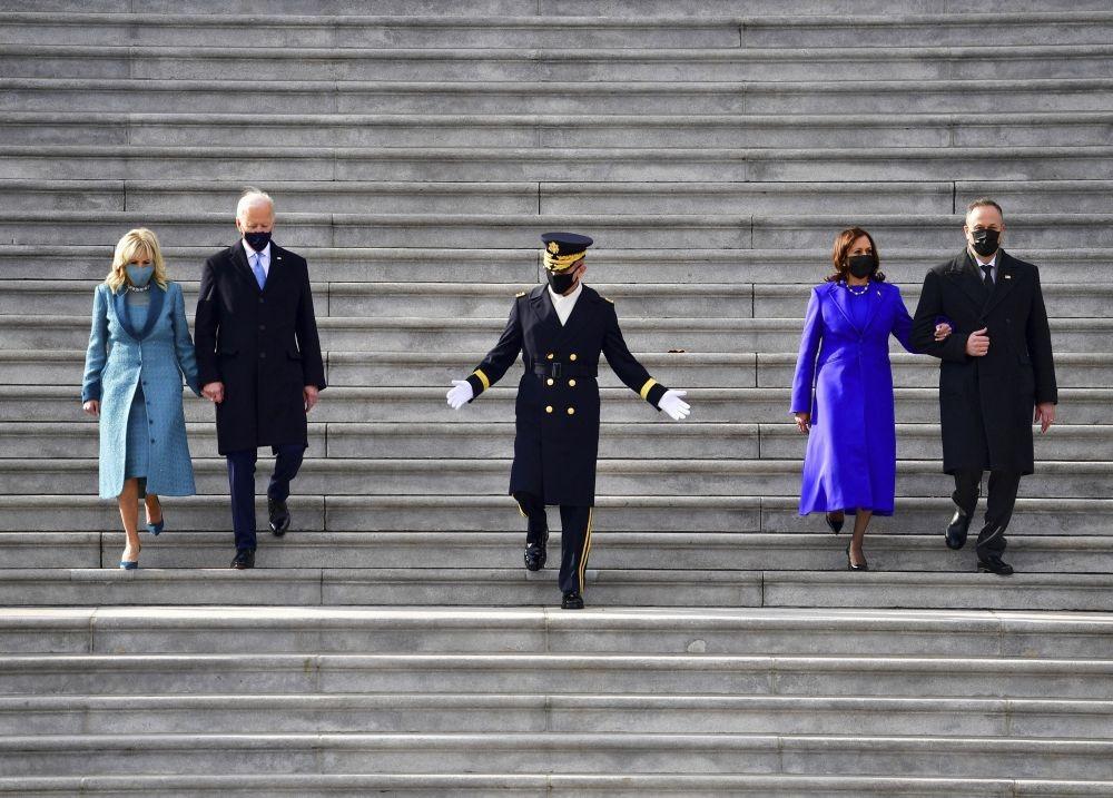 Washington : President Joe Biden, first lady Jill Biden, Vice President Kamala Harris and her husband Douglas Emhoff walk down the steps of the U.S. Capitol after they were sworn into office during the inauguration, Wednesday, Jan. 20, 2021, in Washington. AP/PTI