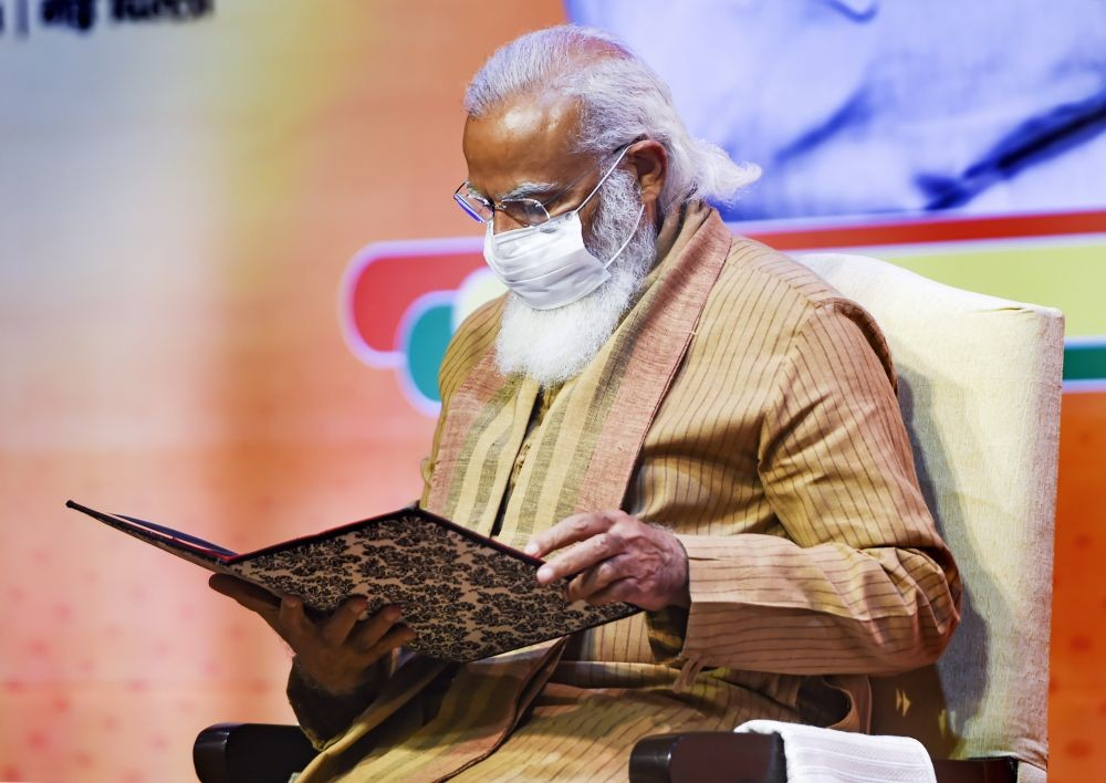 New Delhi: Prime Minister Narendra Modi inaugurates a meeting of the BJP national office bearers at the NDMC convention centre in New Delhi, Sunday, Feb. 21, 2021. (PTI Photo/Shahbaz Khan)