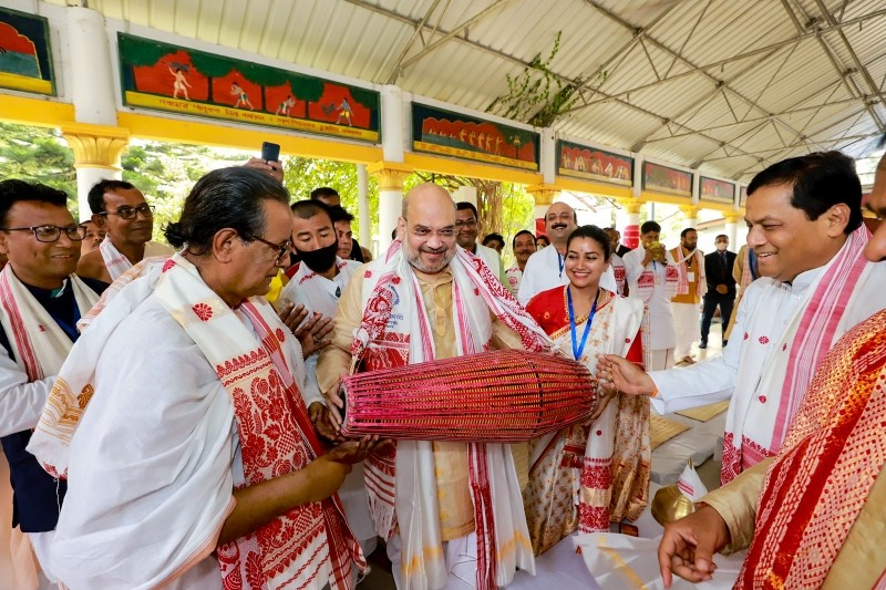 Union Home Minister Amit Shah plays an instrument inside Batadrava Than, the birthplace of Srimanta Sankardev, in Nagaon District of Assam. (PTI Photo)