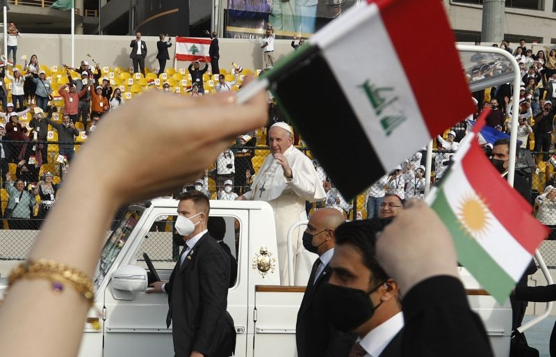 Pope Francis waves as he arrives for an open air Mass at a stadium in Irbil, Iraq on March 7, 2021. Thousands of people filled the sports stadium in the northern city of Irbil for Pope Francis' final event in his visit to Iraq: an open-air Mass featuring a statue of the Virgin Mary that was restored after Islamic militants chopped of the head and hands. (AP/PTI Photo)