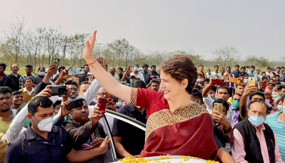 Biswanath: All India Congress Committee (AICC) General Secretary Priyanka Gandhi Vadra waves at tea garden workers on her arrival at Sadharu in Biswanath, Assam. (PTI Photo).