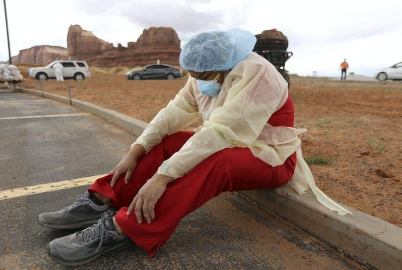 Denise Begaye, an X-ray technician with the Monument Valley Health Center in Oljato-Monument Valley taking a break from her shift on Thursday, April 16, 2020. AP Photo